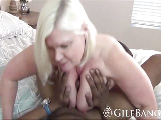 Extreme GILF is big ol tits devouring a monster BBC with tons of saliva on this dark meaty cock