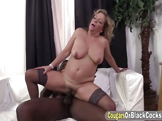 Sexy and busty elderly milf rides on a nice black penis