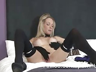 Sexy milf with blonde hair wearing stockings is spreading her vagina for us to get a great view of...
